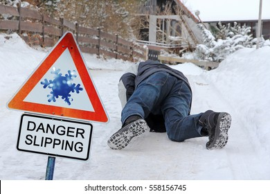 Danger Slipping - Accident danger in winter. A man has slipped and has fallen down
