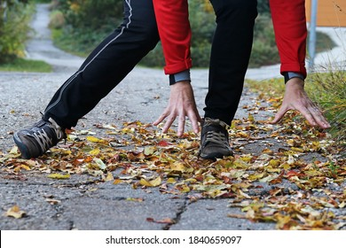 Danger of slipping in autumn and winter. A woman slipped on wet, smooth leaves