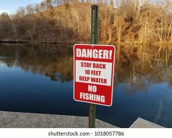 danger stay back deep water no fishing sign near water