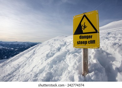 danger steep cliff mountain sign