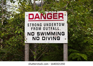 A danger strong undertow, no swimming or diving sign