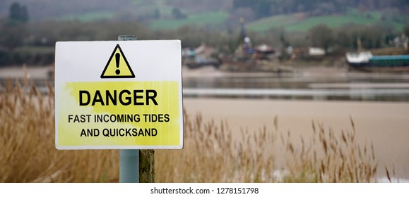 Danger - tides and quicksand sign, United Kingdom