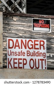 Danger Unsafe Building - Keep Out! and No Trespassing Signs