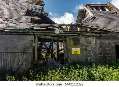 Danger unsafe structure - derelict farm building.
