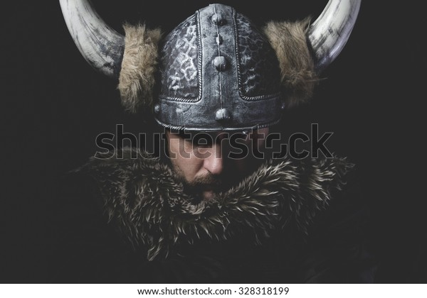 Danger, Viking warrior with iron sword and helmet with horns