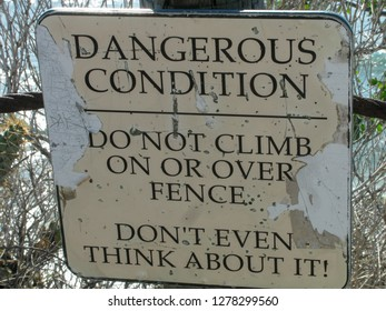 Danger warning sign at the edge of a steep cliff on the Palos Verdes Peninsula near Los Angeles California on the edge of the Pacific Ocean with a sense of humor.