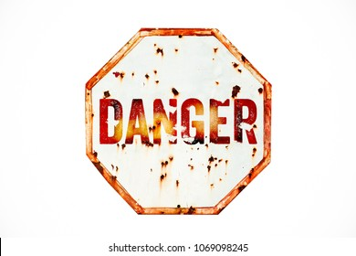Danger warning sign over grungy white and red old rusty road traffic sign texture background. Sign as concept for: do not enter the area, caution, danger or off limits in dangerous areas.