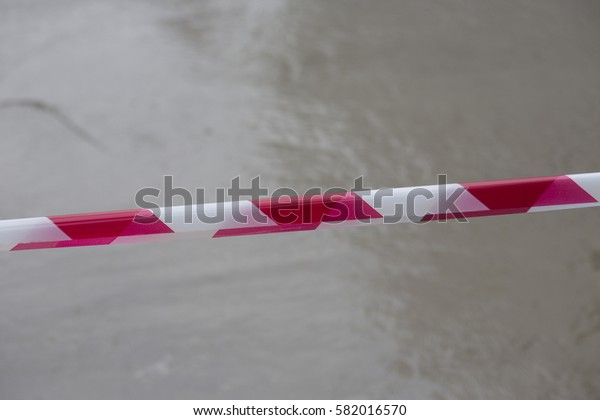 danger zone wet cement and red tape warning