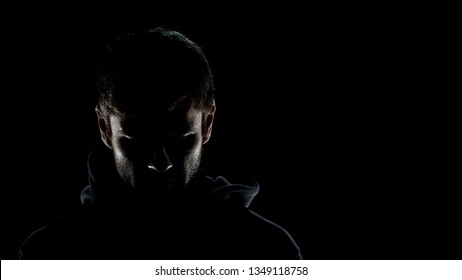 Dangerous anonymous male in night darkness, scary terrorist preparing for crime
