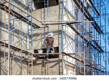 Dangerous Apartment Building Construction with No Safety Equipment for Workers