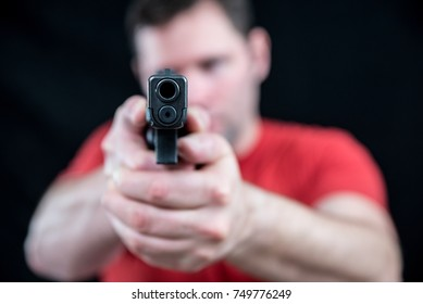 Dangerous Armed Man Pointing Hand Gun