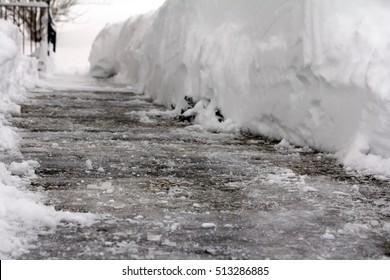Dangerous black ice in a footpath
