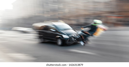 Dangerous city traffic situation with motorcyclist and car in the city in motion blur