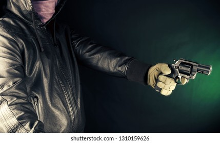 Dangerous criminal hold gun in hand.Large revolver ready for robbery or to commit a homicide. Assassin man.
