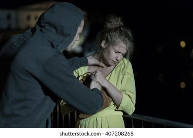 Dangerous criminal strangling woman on the street