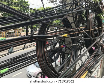 dangerous electrical wires on electric poles.  Including high voltage power electrics, phone communication cable tangled.