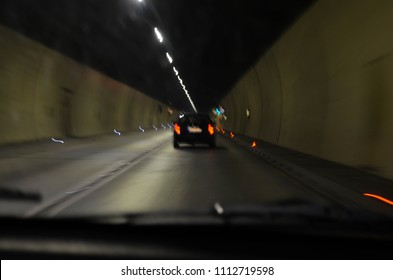 Dangerous and fast driving at night. Fast driving through the tunnel- from the car's passenger point of view.
