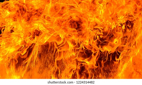 Dangerous fire frames with sparks. Red hot fire frames on black background. Beautiful abstract background on the theme of blaze fiery orange glowing. Creative concept layout template for sale banner.
