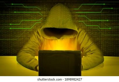 Dangerous hacker behind a laptop screen. Hacking and malware concept, cybersecurity. Digital crimes.