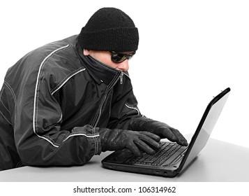 Dangerous hacker with laptop. Data security concept.