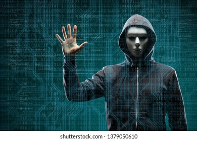 Dangerous hacker over abstract digital background with binary code. Obscured dark face in mask and hood. Data thief, internet attack, darknet fraud, virtual reality and cyber security.