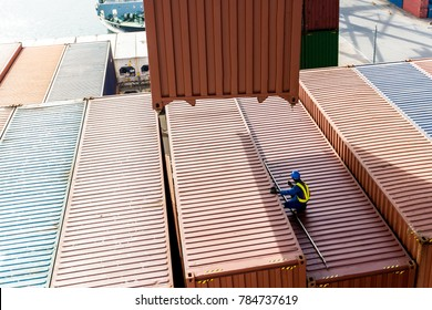 Dangerous job, engineer is checking unloading cargo from container ship