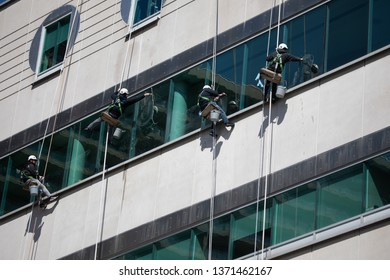 Dangerous Occupation Blue Collar Dangling Rope Window Washers Suspended Building Exterior