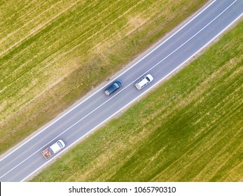 Dangerous overtaking of cars from police drone perspective. Aerial view of road traffic.