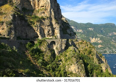 Dangerous road along the side of the cliffs of the Amalfi coast in Italy