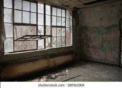 dangerous room and windows in an abandon mental hospital