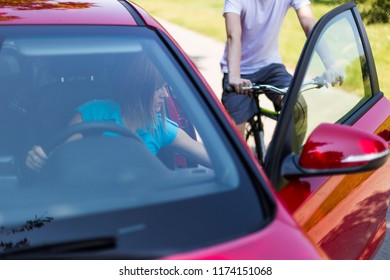 Dangerous situation with cyclist and car. Open car door puts cyclists in great danger