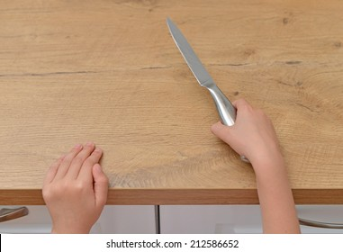 Dangerous situation in the kitchen. Child is trying to get a kitchen knife.