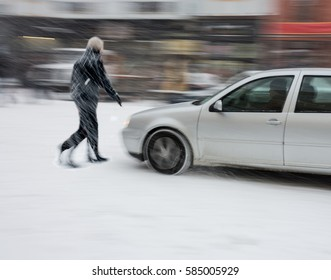 Dangerous situation on city road in winter time. Intentional motion blur