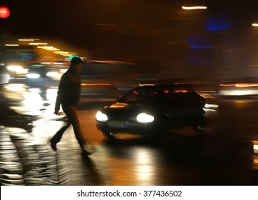 Dangerous situation on zebra crossing at night. Intentional motion blur