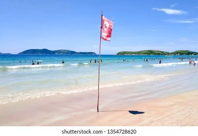 Dangerous - Strong current sign - Praia do Pero, Cabo Frio, Rio de Janeiro, Brazil (Pero's beach) - Shutterstock ID 1354728620