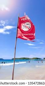 Dangerous - Strong current sign - Praia do Pero, Cabo Frio, Rio de Janeiro, Brazil (Pero's beach) - Shutterstock ID 1354728626
