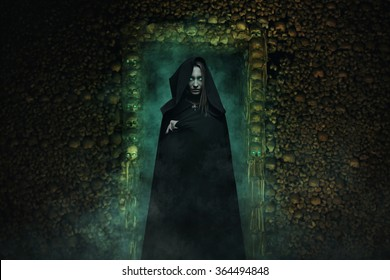 Dangerous vampire in catacombs full of skulls and bones . Horror and fantasy