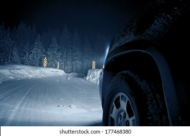 Dangerous Winter Road at Night. Colorado Road Drive in Snow Storm.