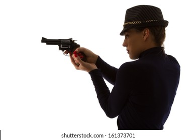 Dangerous woman in black with big handgun and stylish hat silhouette