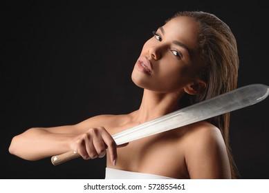 Dangerous woman carrying big sword