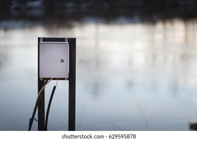 Dangerously swollen river flooded electrical cabinet