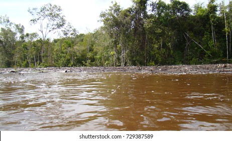 Dangers lurking in every corner.  The rising muddy water in the swollen river hampers transportation upriver during the floods and monsoon seasons.
