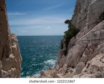 Dangorous path along the rockface, italy