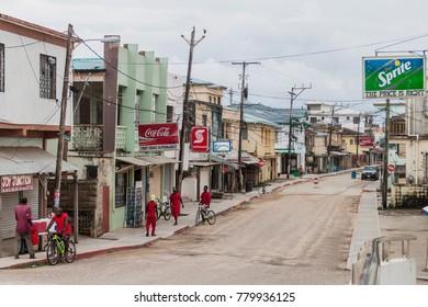 DANGRIGA, BELIZE - MARCH 6, 2016: Local people on a street in Dangriga town, Belize