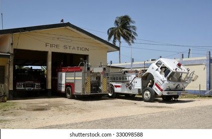 Dangriga, Belize, - May 26, 2015: Fire truck having maintenance work on the frontage of the fire station in Dangriga, Stann Creek District, Belize.