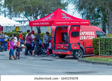 Dania Beach, FL / USA - 2/8/2020: People at the festival, eating and enjoying the music at the Tri-Rail Rail Fun Day 2020 at Fort Lauderdale - Hollywood International Airport station.