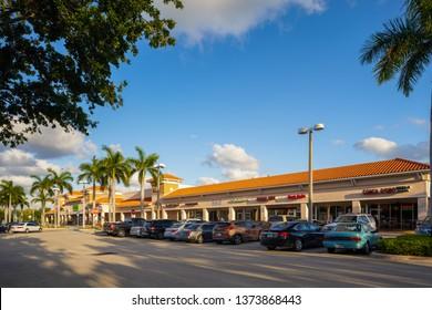 DANIA BEACH, FL, USA - APRIL 17, 2019: Stock photos of Dania Beach RK Shopping Plaza and Publix Supermarket anchor tenant