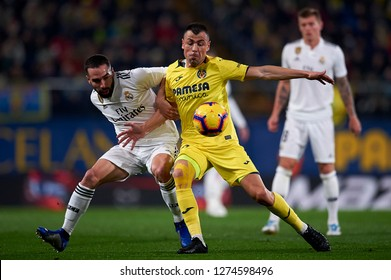Daniel Carvajal of Real Madrid and Javi Fuego of Villarreal competes for the ball during the match between Villarreal CF and Real Madrid at Ceramica Stadium in Villarreal, Spain on January 3 2019.