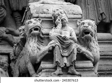 Daniel in the lions' den. Architectural detail. Facade of the church of St. Trophime in Arles. (Provence, France) Aged photo. Black and white.