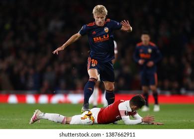 Daniel Wass of Valencia fouls Lucas Torreira of Arsenal - Arsenal v Valencia, UEFA Europa League Semi Final - 1st Leg, Emirates Stadium, London (Holloway) - 2nd May 2019